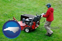 north-carolina map icon and a lawn mowing service