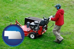 nebraska map icon and a lawn mowing service