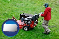 pennsylvania map icon and a lawn mowing service